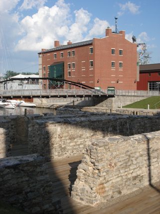 The reconstructed Commercial Slip and bridge, historic building ruins, interpretive elements, museum, and park